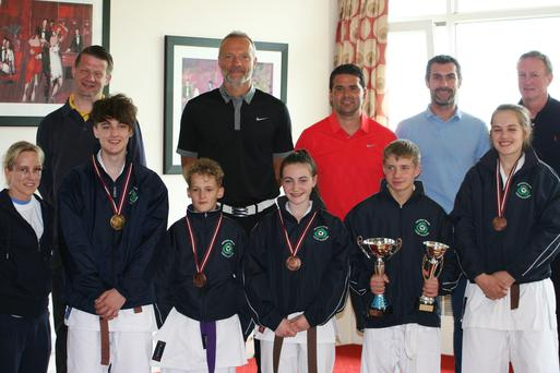North stars: Karate coach Cathy McAleer with Sol Boyles, Christian Boyles, Lucy Ouldfield, Fergus McMullan and Effie Ellis O'Neil meet Maik Taylor, David Healy, Keith Gillespie and Michael O'Neill
