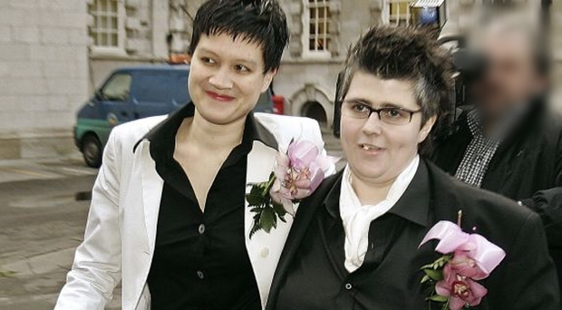 Grainne Close (right) and Shannon Sickles become the first gay couple in the UK to enter into a civil partnership during a ceremony at the City Hall in December 2005