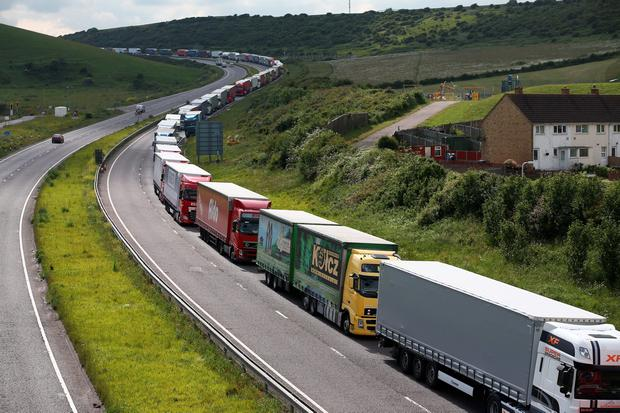 Trucks queue up as part of Operation Stack on June 23, 2015 in Dover, England. Ferry workers blockaded the port of Calais in a protest over job cuts earlier on Tuesday. (Photo by Carl Court/Getty Images)