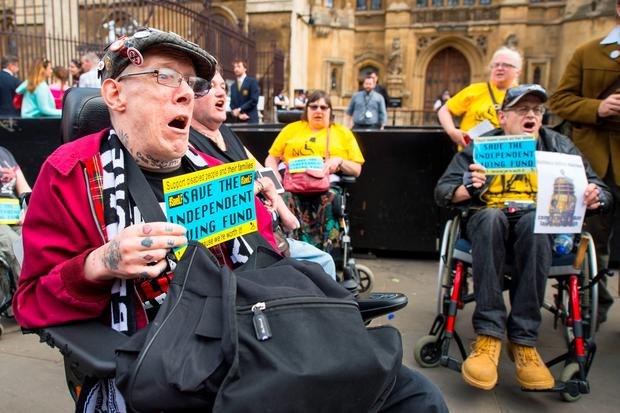 Disability rights campaigners protest outside the Houses of Parliament, in Westminster, London, after they had disrupted a session of Prime Minister's Questions. Photo: Dominic Lipinski/PA