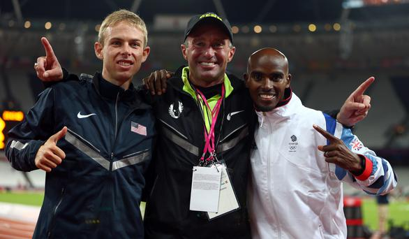 Under-fire: Alberto Salazar with Mo Farah and Galen Rupp after the men's 10,000m final at the London Olympics