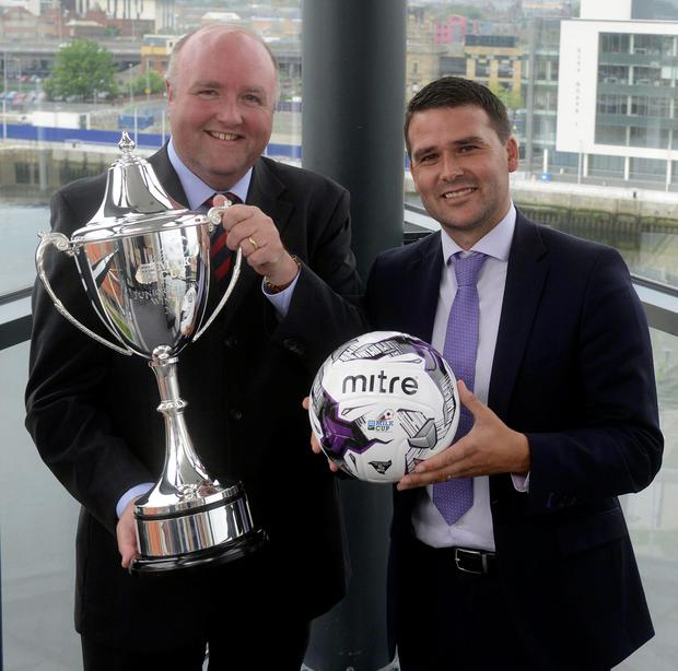 Cream of the crop: David Healy and Jason Hempton (Dale Farm) pictured at the draw for the 2015 Dale Farm Milk Cup in W5 at the Odyssey Arena yesterday PACEMAKER