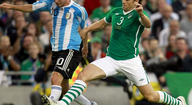Star draw: The Republic's Kevin Kilbane puts Lionel Messi of Argentina under pressure during a friendly encounter in 2010