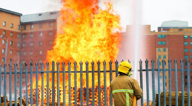 Premature incineration: Sandy Row bonfire set alight early on Thursday June 25. Picture - Kevin Scott / Presseye