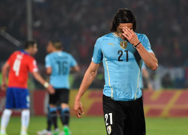 Uruguay's forward Edinson Cavani leaves the pitch after being red-carded during their 2015 Copa America football championship quarterfinal match against Chile, in Santiago, on June 24, 2015. AFP/Getty Images
