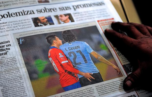 The front page of an Uruguayan newspaper shows on June 25, 2015 in Montevideo a picture of Chile's football team defender Gonzalo Jara provoking Uruguay's Edinson Cavani. AFP/Getty Images
