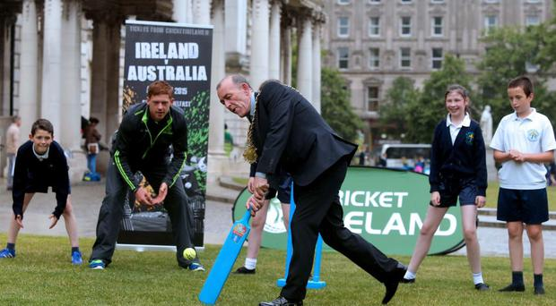 A big hit: Lord Mayor Arder Carson shows his cricket skills watched by Ireland international Craig Young and pupils from Donegall Road and St John Baptist Primary schools