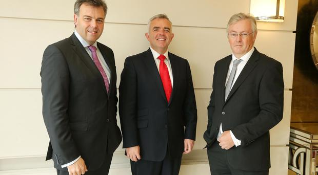 Alastair Hamilton of Invest NI with Enterprise Minister Jonathan Bell and CBI chairman Colin Walsh at the business breakfast in the Ramada Plaza in Belfast. Pic Kelvin Boyes / Press Eye