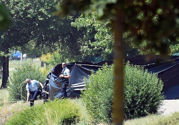 French security stand next to the enclosed area where a decapitated body was found near the Air Products company in Saint-Quentin-Fallavier, near Lyon, central eastern France, on June 26, 2015. An attacker carrying an Islamist flag killed one person and injured several others at a gas factory in eastern France, according to a legal source. The suspected attacker entered the factory and set off several small explosive devices, the source said. AFP PHOTO/PHILIPPE DESMAZEPHILIPPE DESMAZES/AFP/Getty Images