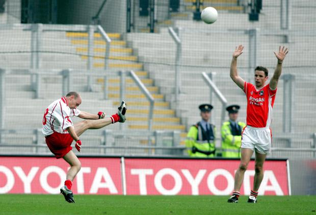 Magical moment: Peter Canavan kicks the winning point in the All-Ireland semi-final against Armagh in 2005