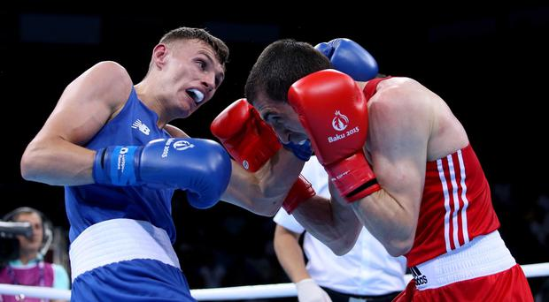 Squaring up: Ireland's Sean McComb (left) loses out to Albert Selimov of Azerbaijan yesterday