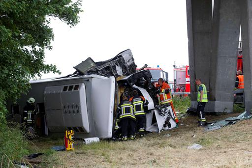 Rescue services work at the site where a bus carrying 34 British schoolchildren crashed off the E40 highway in Middelkerke, Belgium. AFP PHOTO / BELGA / NICOLAS MAETERLINCK.
