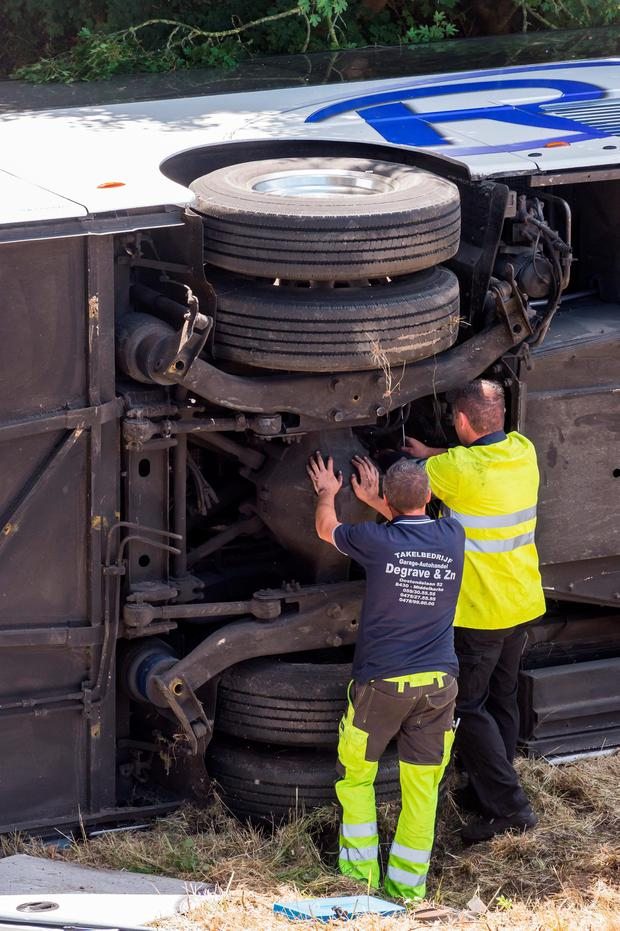 Safety workers attend to the Richmond Coach's bus which crashed on a motorway in Middlekerke, Belgium on Sunday. (AP Photo/Geert Vanden Wijngaert)