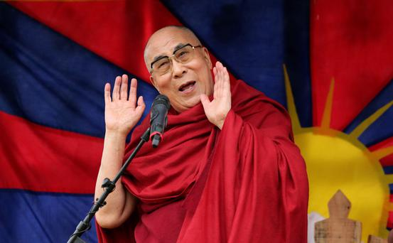 The Dalai Lama at the Glastonbury Festival, at Worthy Farm in Somerset, where he addressed campers. Yui Mok/PA Wire.