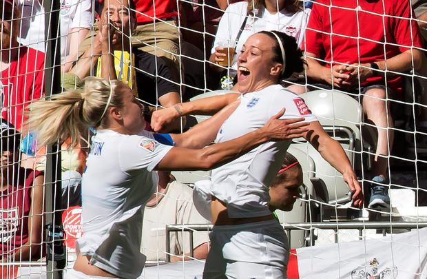 England's Lucy Bronze, right, celebrates her goal with teammate Steph Houghton during the first half of a quarterfinal against Canada in the Women's World Cup soccer tournament, Saturday, June 27, 2015, in Vancouver, British Columbia, Canada. (Jonathan Hayward/The Canadian Press via AP)