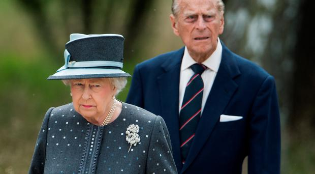 The Quuen and the Duke of Edinburgh have sent their condolences to the families of those killed and injured in the Tunisian beach massacre. (Photo by Julian Stratenschulte - Pool/Getty Images)