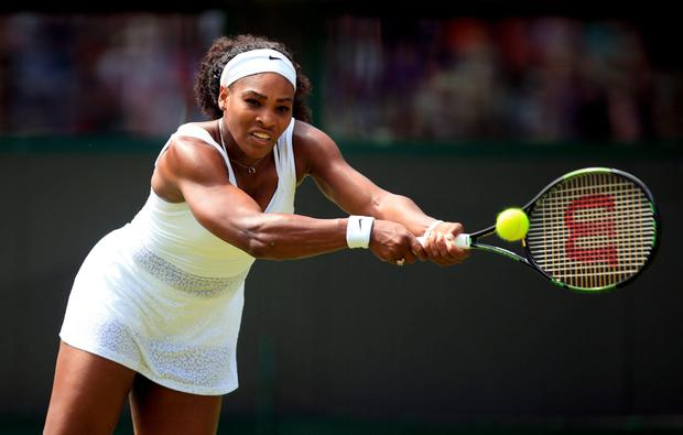 Serena Williams in action against Margarita Gasparyan in the the First round women's singles during day one of the Wimbledon Championships at the All England Lawn Tennis and Croquet Club, Wimbledon.