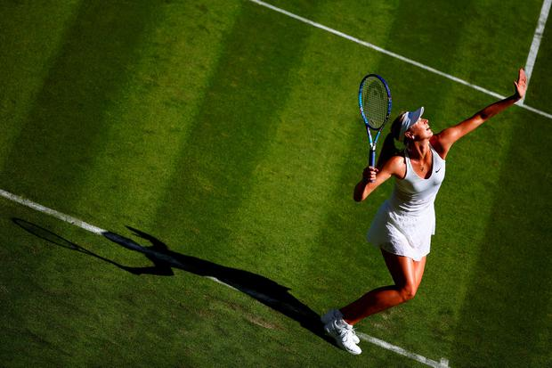 Maria Sharapova serves in first round match against Johanna Konta during day one of Wimbledon (Photo by Julian Finney/Getty Images)