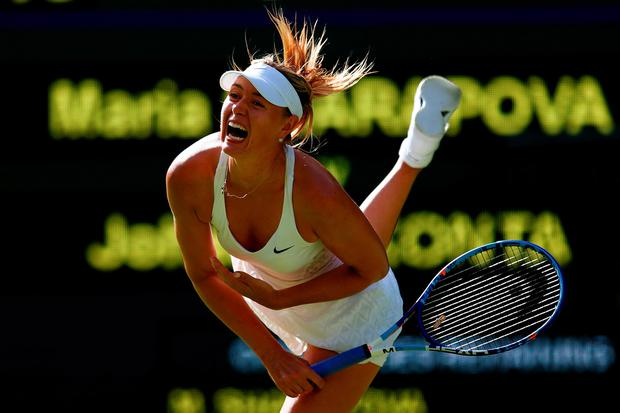 Maria Sharapova of Russia serves in her Ladies Singles first round match against Johanna Konta (Photo by Julian Finney/Getty Images)