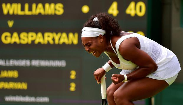US player Serena Williams reacts to her first set come back against Russia's Margarita Gasparyan