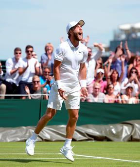 Liam Broady celebrates victory over Marinko Matosevic during day one of the Wimbledon Championships at the All England Lawn Tennis and Croquet Club, Wimbledon. PRESS ASSOCIATION Photo. Picture date: Monday June 29, 2015. See PA Story TENNIS Wimbledon. Photo credit should read Adam Davy/PA Wire. RESTRICTIONS: Editorial use only. No commercial use without prior written consent of the AELTC. Still image use only - no moving images to emulate broadcast. No superimposing or removal of sponsor/ad logos. Call +44 (0)1158 447447 for further information.
