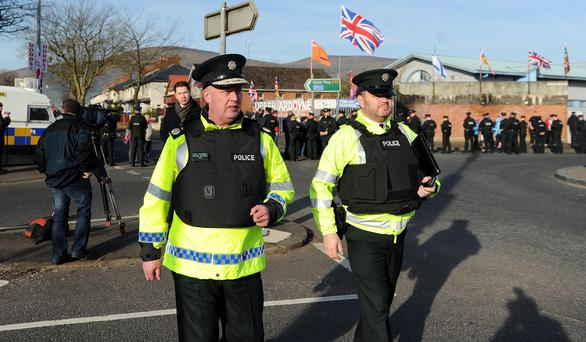 Chief Constable George Hamilton (left) at the Ardoyne interface during a march in April  Declan Roughan