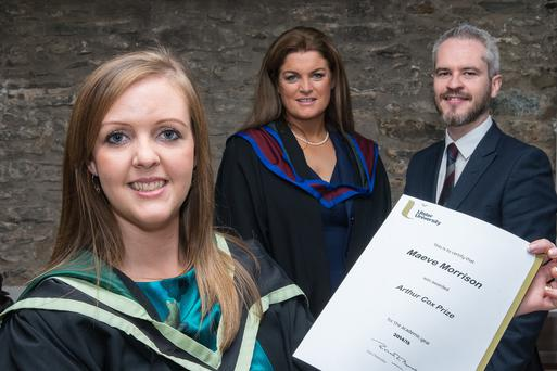 Maeve Morrison from Ulster University who has received the Arthur Cox Prize for First Overall in the Postgraduate Diploma in Legal Practice from Adrian Kerr of Arthur Cox. Included is Dianne Nixon, Head of the Graduate School, Graduate School of Professional and Legal Education.