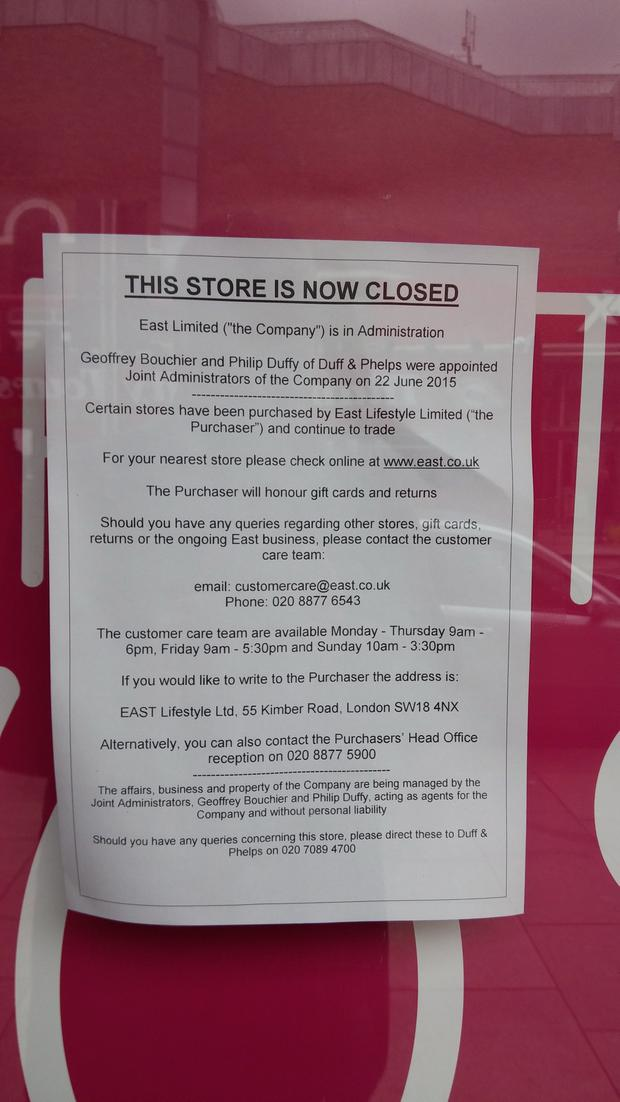A notice on the door of East showing the store has now closed