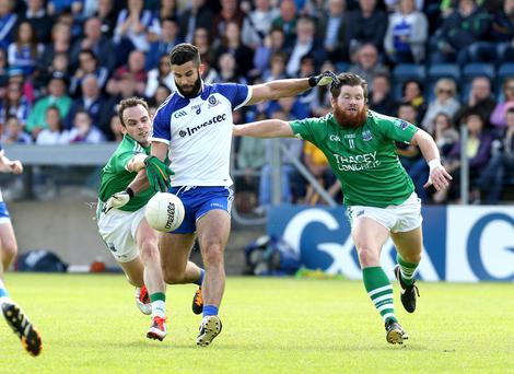 Beard to beard: Monaghan's Neil McAdam is hounded by Ciaran Flaherty of Fermanagh