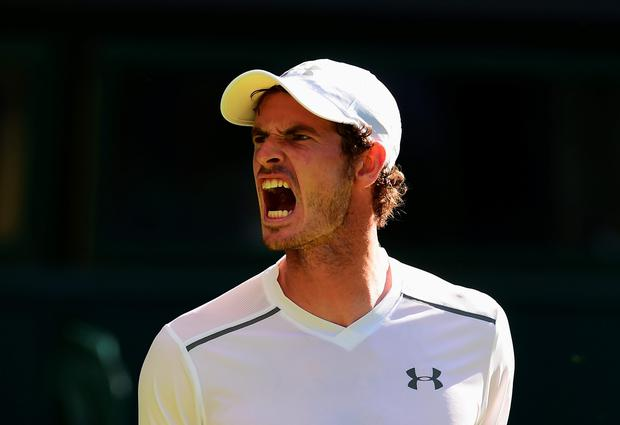 Scotland's Andy Murray reacts in his Gentlemens Singles first round match against Mikhail Kukushkin of Kazakhstan (Photo by Shaun Botterill/Getty Images)