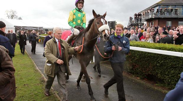 Ruby Walsh and Kauto Star are led into the Down Royal winners enclosure in 2010