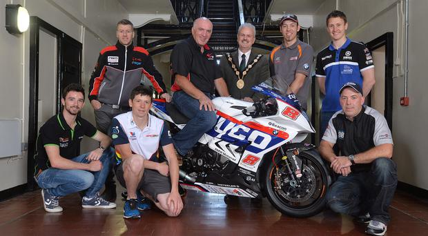 Raring to go: (back row, l-r): Ian Hutchinson, Noel Johnston, Clerk of the Course at the Metzeler Ulster Grand Prix, Cllr Thomas Beckett, Mayor of Lisburn & Castlereagh City Council, Peter Hickman and Dean Harrison. (Front row l-r): Glenn Irwin, Dan Kneen and Paul Owen