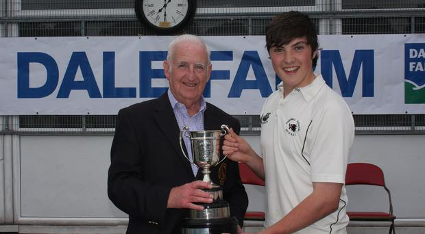 Winner: Civil Service North captain James Pollard receives the Graham Cup from NCU president Billy Boyd