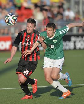 Eyes on the prize: Crusaders' Michael Carvill chases for the ball with Artur Pikk of Levadia