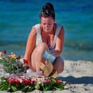 Holidaymakers lay flowers on Marhaba beach in Sousse, where 38 people were killed in last Fridays terror attack on June 30, 2015 in Sousse, Tunisia. British police have been deployed to the area in one of the biggest counter terror operations since the London bombings on 7 July 2005. (Photo by Jeff J Mitchell/Getty Images)