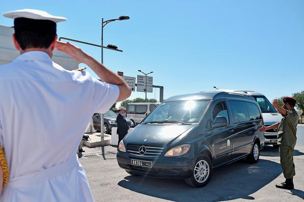 Ambulances carrying the victim's of last Friday's terrorist attack arrive at Tunis Airport