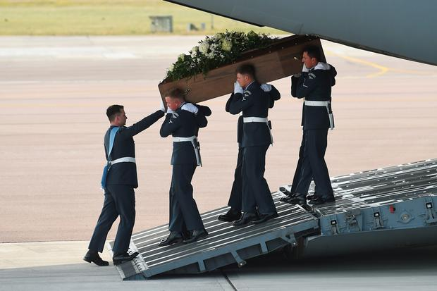 The coffin of Denis Thwaites, one of the victims of last Friday's terrorist attack, is taken from the RAF C-17 aircraft at RAF Brize Norton in Tunisia, on July 1, 2015 in Brize Norton, England. (Photo by Joe Giddens-WPA Pool/Getty Images)