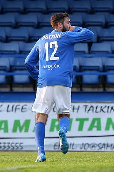 Get in: Mark Patton celebrates his goal for the Lurgan Blues