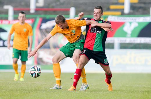 Picture - Kevin Scott / Presseye Belfast - Northern Ireland - Thursday 2nd July 2015 - Glentoran v MSK Zilina Pictured is Glentorans' Conor McMenamin and Zilinas' Denis Vavro in action during the first leg of the Europa Cup tie at the Oval in Belfast Picture - Kevin Scott / Presseye