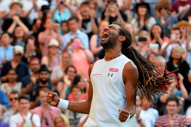 Germany's Dustin Brown celebrates beating Spain's Rafael Nadal during their men's singles second round match on day four of the 2015. AFP/Getty Images