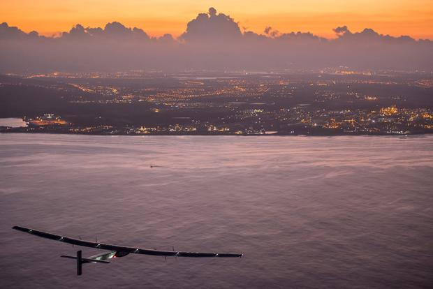 Solar Impulse2, a solar powered plane piloted by Swiss Andre Borschberg, approaching Kalaeloa Airport, O'ahu, Hawaii, finishing the 8674 Kilometer long flight from Nagoya, Japan with an 118 hours record flight. Jean Revillard/SI2/Global Newsroom/PA Wire.