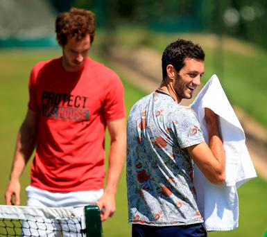Inspired by Andy: James Ward (right) smiles during his practice sessions with Andy Murray yesterday