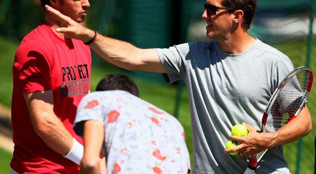 Top team: Coach Jonas Bjorkman gives Andy Murray some words of wisdom