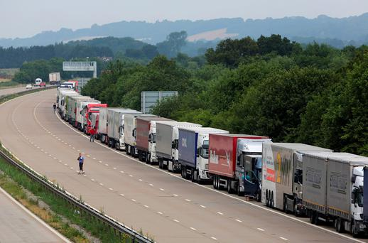 Lorries parked on the M20 in Ashford as Kent Police reintroduced Operation Stack after around 150 migrants tried to storm the Channel Tunnel terminal in Calais in a bid to board UK-bound freight. Gareth Fuller/PA Wire