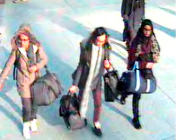 (Left to right) 15-year-old Amira Abase, Kadiza Sultana, 16, and Shamima Begum, 15, at Gatwick airport in February, as the families of two east London schoolgirls who fled to Syria to join the Islamic State (IS) have lost hope that the teenagers will return after discovering they have been married off to militants. Met Police/PA Wire.