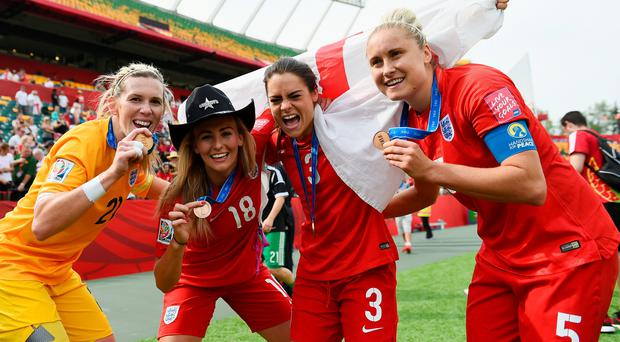 Bronze winners: Steph Houghton (right) celebrates with Carly Telford, Toni Duggan and Claire Rafferty after beating Germany
