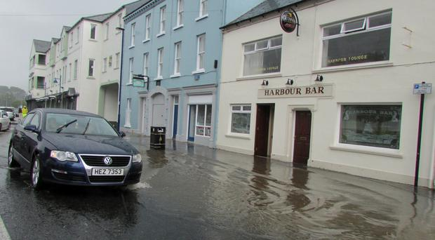 Flash floods which swamped parts of Ballycastle yesterday as the force of the water caused manhole covers to burst