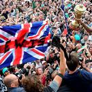 Title charge: Lewis Hamilton toasts his home win at Silverstone with fans