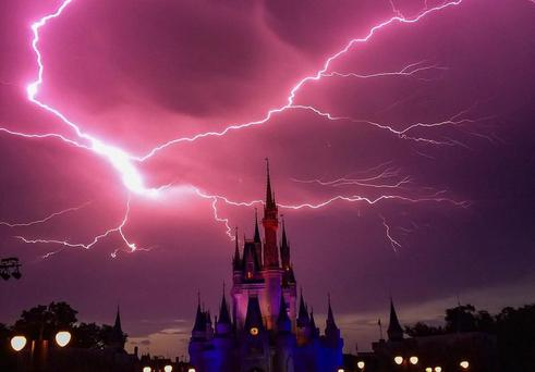 Lightning above the Cinderella Castle at Disney World's Magic Kingdom Park. Pic Instagram/Melaroo