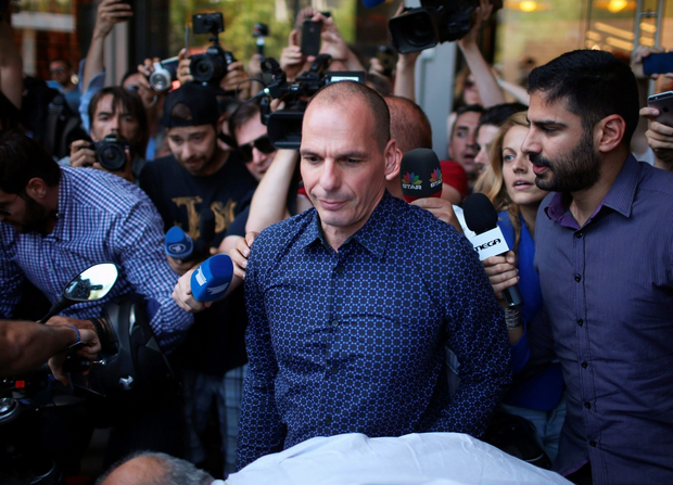 Former Greek finance minister Yanis Varoufakis faces a barage of media questions as he leaves the finance ministry after resigning this morning on July 6, 2015 in Athens, Greece. (Photo by Christopher Furlong/Getty Images)